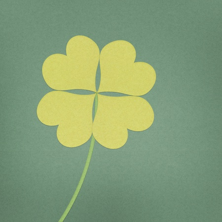 recycle paper clover with four leaves on grunge background Stock Photo - 12354156