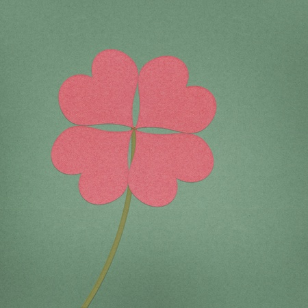 recycle paper clover with four leaves on grunge background Stock Photo - 12354157
