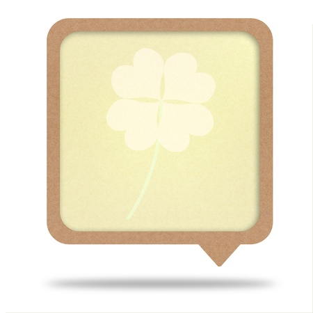 clover with four leaves on recycle paper talk tag Stock Photo - 12354062