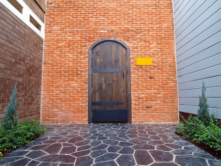 Brick Wall with a  Door Stock Photo - 12354056