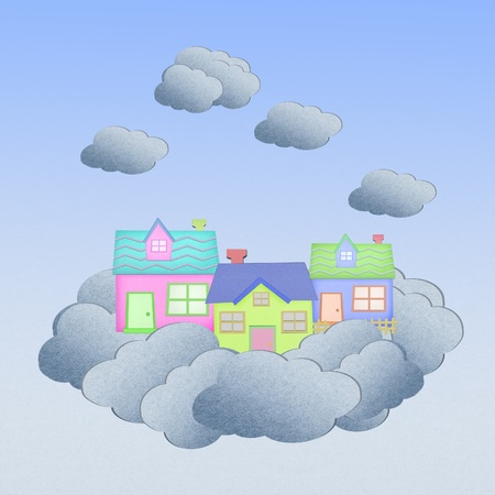 house from recycle paper on a cloud over the sky photo