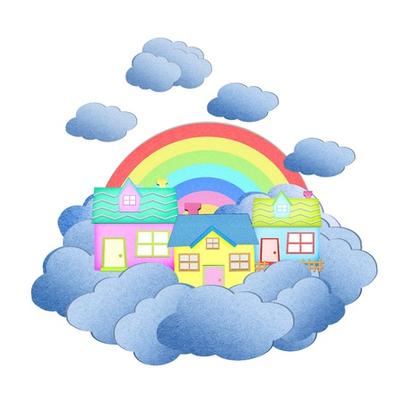 house from recycle paper on a cloud over the sky with rainbow photo