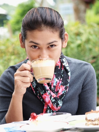 Asian woman drinking a coffee Stock Photo - 13105388