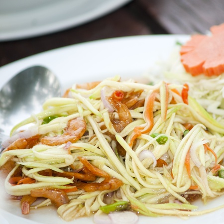 Mango salad a delicious and famous vegetable appetizer from Thailand. photo