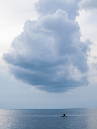 kayaking on sea and a big cloud photo