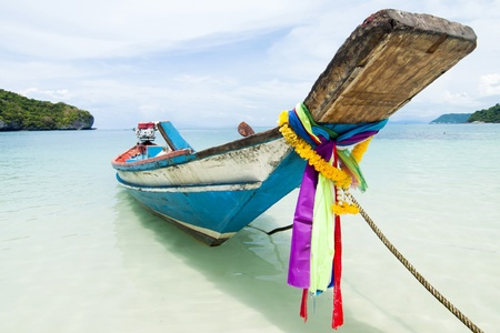long tail boat sit on the beach, Samui island, Thailand photo
