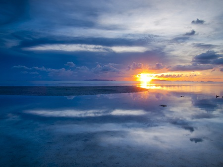 The sun sets over beach with beautiful reflection Stock Photo - 13447816