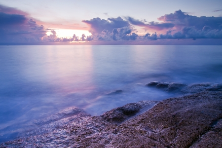 Beautiful seascape. Sea and rock at the sunset Stock Photo