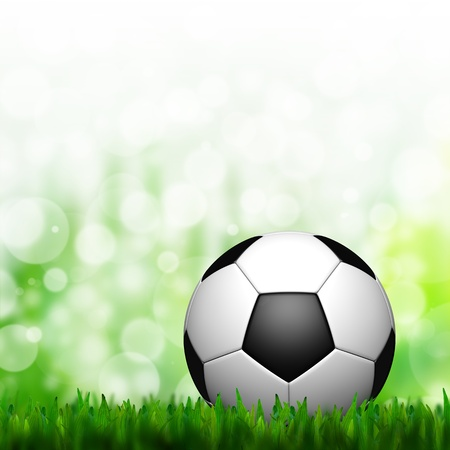 3D Football in green grass and background photo