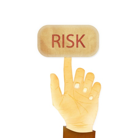 Paper texture ,Hand gesture pointing at Risk button Stock Photo - 14696635