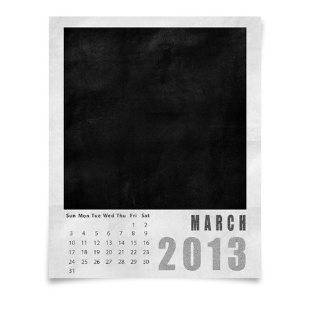 2013 year calendar ,March on blank photo frame isolated on white photo