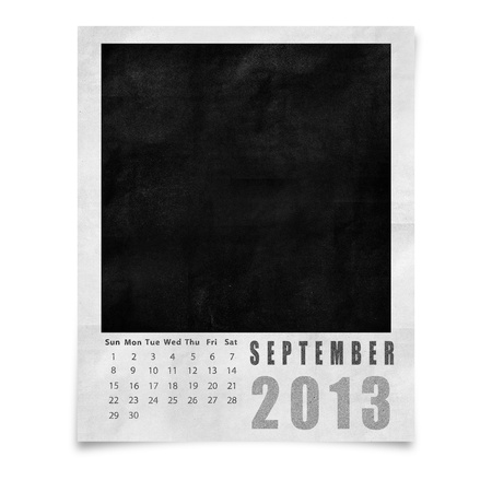 2013 year calendar ,September on blank photo frame isolated on white photo