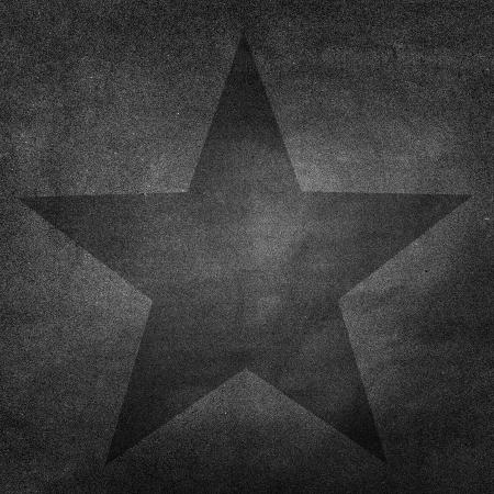 Black star on Grunge paper background photo