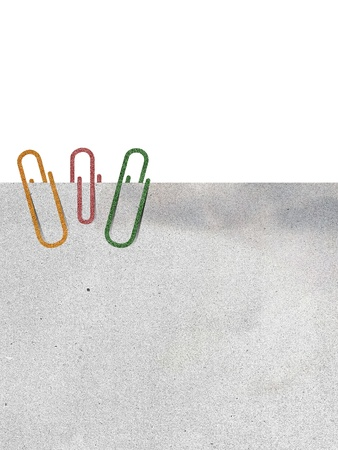 paper clip and paper on white background photo