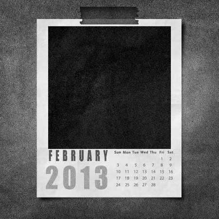 2013 year calendar February on black paper board background photo