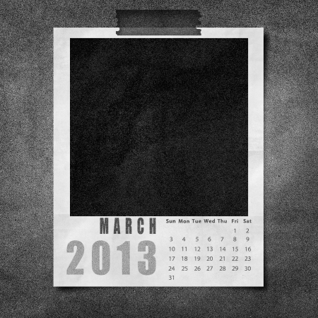 2013 year calendar March on black paper board background photo