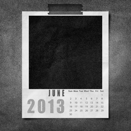 2013 year calendar June on black paper board background photo
