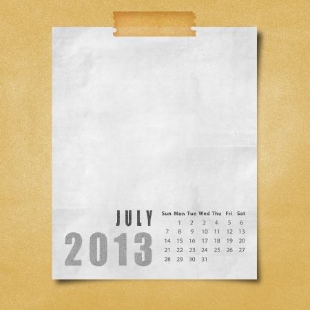 2013 year calendar July on paper board background photo