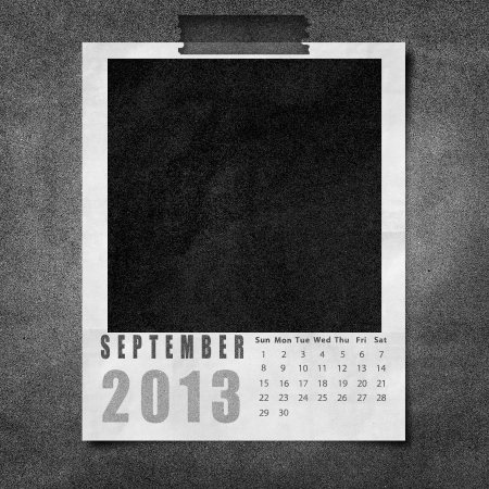 2013 year calendar September on black paper board background photo