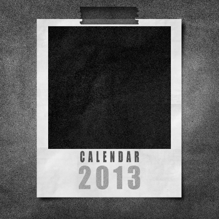 2013 year calendar Cover on black paper board background photo