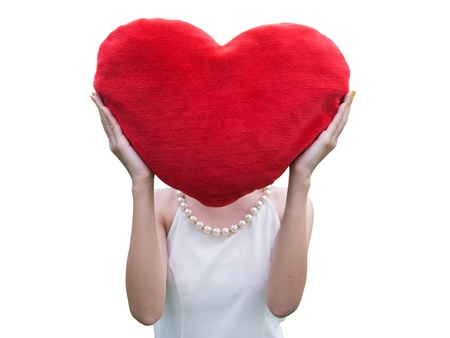 Women holding big love heart shape pillow isolated on white background, photo