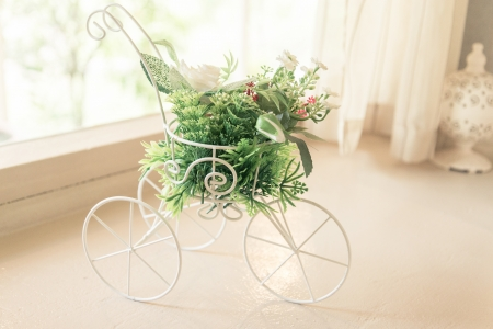 Vintage tone bicycle with artificial flower -  home interior photo
