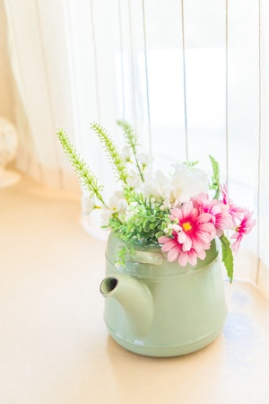 Vintage tone artificial flower on pot -  home interior photo