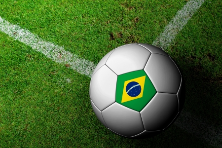 Brazil Flag Pattern of a soccer ball in green grass Stock Photo