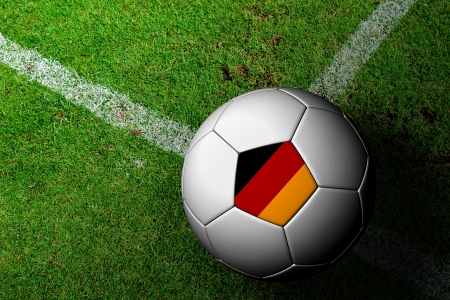 Germany Flag Pattern of a soccer ball in green grass photo