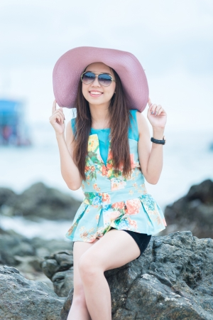 A portrait of beautiful asian woman on the seashore photo