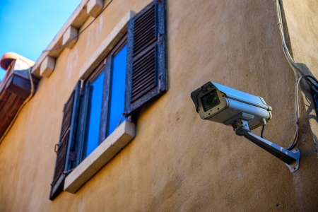 windows with cctv on wall photo
