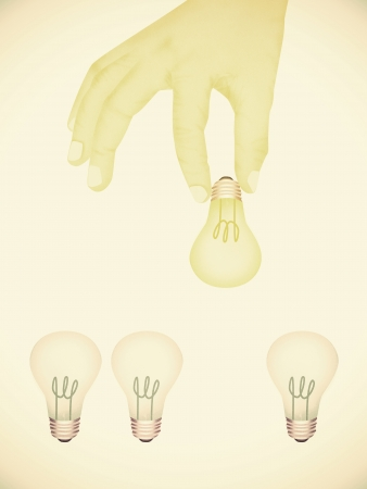 Paper texture ,  illustration of hand picking bright light bulb illustration