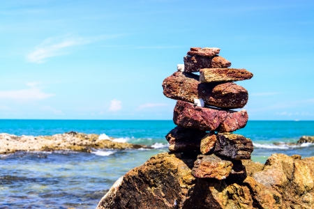 Stack of pebbles balancing on a sky background