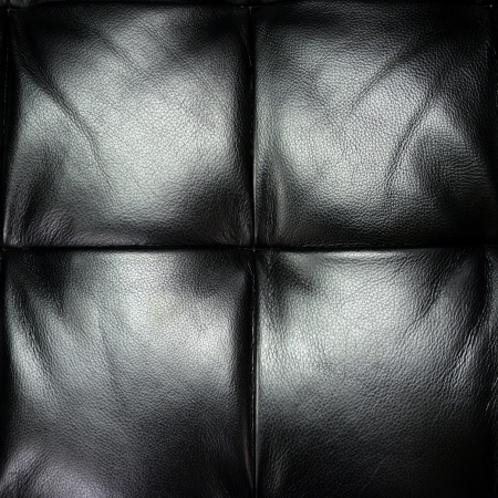 Dark leather texture of sofa closeup shot photo