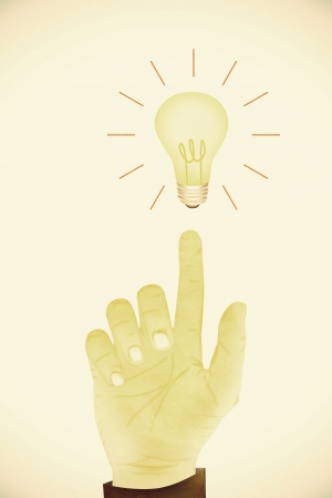 Old Paper texture ,Hand gesture direction bulb idea Stock Photo - 22759714