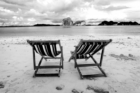 Beach chairs and beautiful beach on black and white tone Stock Photo