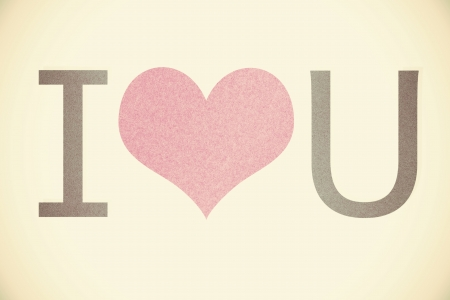 'i love you' recycled paper on vintage tone background photo
