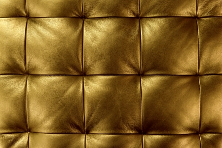 Luxury golden leather close-up background photo