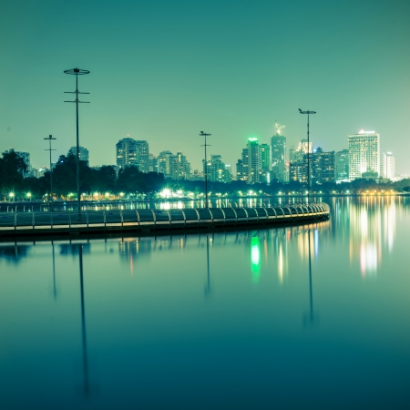 benjakitti: City at night with reflection of skyline,Vintage tone Stock Photo