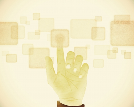Paper texture ,Hand gesture pushing button on touch screen on vintage tone background photo
