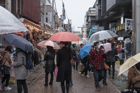 younger: HARAJUKU, TOKYO - March 01, 2015: Takeshita Street, pedestrian street with many fashion boutiques, groceries, restaurants and cafes. Takeshita Dori is very popular among younger generations.