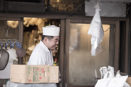 fish vendor: Tokyo, Japan - March 03, 2015: Famous Tsukiji fish market shops. Tsukiji is the biggest fish market in the world, with a vast varaiety of Fish and Sea food
