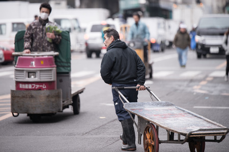 biggest: Tokyo, Japan - March 03, 2015: Famous Tsukiji fish market shops. Tsukiji is the biggest fish market in the world, with a vast varaiety of Fish and Sea food