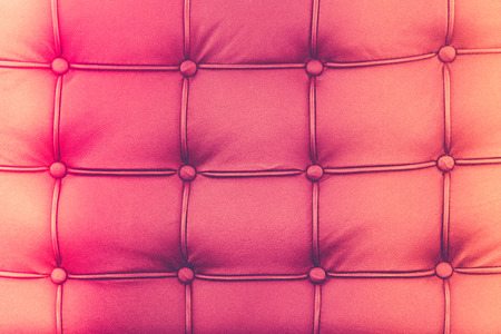 loveseat: picture of red genuine leather (filter effect used) Stock Photo