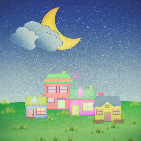recycle paper: house from recycle paper with moon in night time
