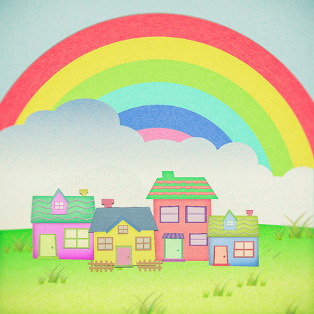 proprietor: house from recycle paper with grass field rainbow background Stock Photo