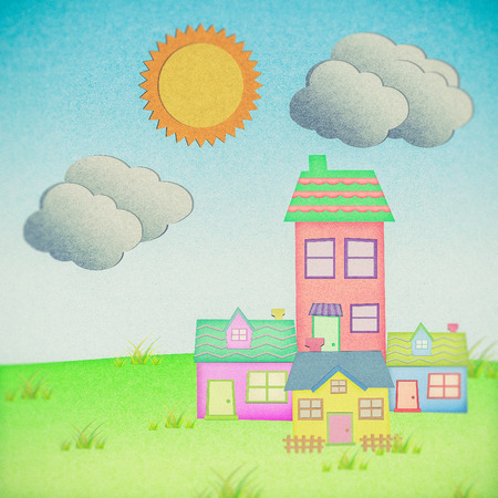 house from recycle paper with grass field with sun and  cloud