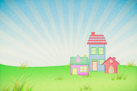 house from recycle paper with grass field and blue sky Stock Photo