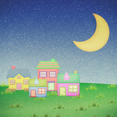 night time: house from recycle paper with moon in night time