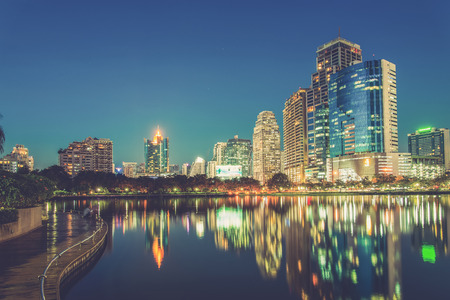 City downtown at night with reflection of skyline,Emerald green tone (Vintage filter effect used) Stock Photo